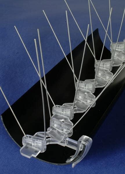 Gutter clips for bird spikes
